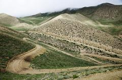 meandering high mountain roads at upper mustang, nepal - stock photo