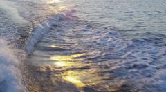 Sailboat Wake Foam in Ocean at Sunset - stock footage
