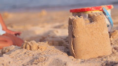 Children toys in the sand on the beach Stock Footage