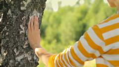 Girl hand touching a tree, love for the nature, camera movement Stock Footage