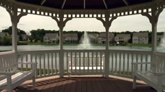Gazebo overlooking lake Stock Footage