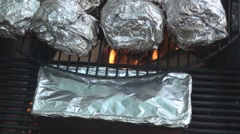 Close up of food grilling on the fire pit Stock Footage