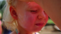 Slow motion 96fps Sun protection face child Stock Footage