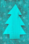 Christmas background in turquoise green color of a handmade carved tree. Stock Photos