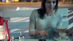 Young woman gets delicious coffee from waiter in cafe HD Stock Footage