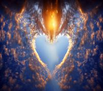 Heart shape made of clouds on a sunset sky. love, romance, religion concepts Stock Photos