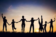 Happy group of people, friends, family standing together hands in hands, havi Stock Photos