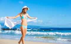 Beautiful young woman on the beach Stock Photos