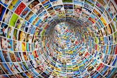 Tunnel of media, images, photographs. tv, multimedia broadcast, streaming. al Stock Illustration