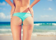 sexy woman in small bikini on the beach - stock photo