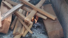 Starting fire in the fire pit 3 Stock Footage