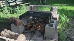 Starting fire in the fire pit 5 Stock Footage