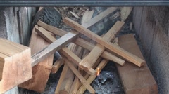 Starting fire in the fire pit Stock Footage