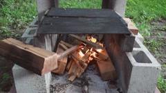 Starting fire in the fire pit 7 Stock Footage