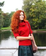 Fashion woman  in autumn park Stock Photos