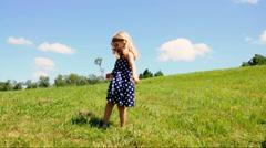 Little Girl Running Outside on Grass Stock Footage