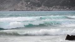 Surfing in Porto Ferro Stock Footage