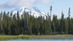 South Sister and Little Lava Lake, Oregon (zoom out) Stock Footage
