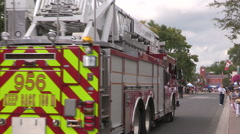 Firefighters charity fundraiser car wash using fire trucks Stock Footage