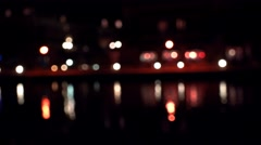 Nighttime Water City Buildings Lights Reflections in Water at Night Stock Footage