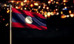 Laos National Flag City Light Night Bokeh Background 3D - stock illustration