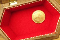 Gold coin with copy space Stock Photos