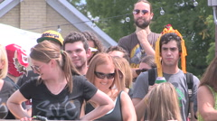 People drinking and partying on the patio on hot sunny summer day Stock Footage