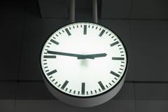 Clock on sky train station in bangkok, thailand Stock Photos