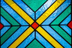 Stained glass with multi colored background Stock Photos