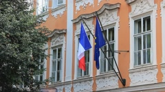 Flag of France and European Union on a French Embassy building in Prague. - stock footage