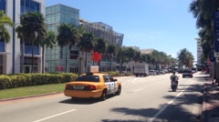 Taxis driving through the street of Miami Beach, USA - stock footage