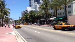 Traffic at Collins Avenue in Miami Beach, USA Stock Footage