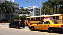 Yellow taxis and school bus in the streets of Miami Beach, USA Stock Footage