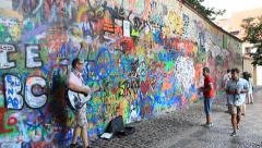 The Lennon Wall or John Lennon Wall, is a wall in Prague, Czech Republic. Stock Footage