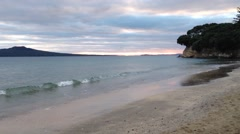 Takapuna beach in the morning with rangitoto island on the background - stock footage