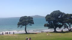 Pan Takapuna beach with rangitoto island on the background Stock Footage