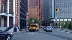 Pan from a schoolbus passing by in lower Manhattan, New York City, USA Stock Footage