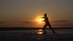 Sport sexy girl silhouette on nature sunset Stock Footage