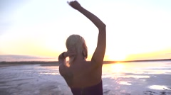 Sport sexy happy girl model silhouette dancing on nature sunset - stock footage