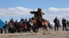 GOLDEN EAGLE HUNTER FESTIVAL HORSEMAN Stock Footage