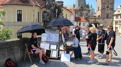 Prague. Man draws caricatures on a Charles bridge. Stock Footage