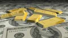 Dolly shot across $ 100 bills and gold bars Stock Footage