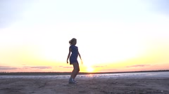 Sport sexy young girl silhouette dancing and jumping on nature sunset - stock footage