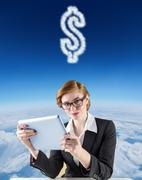 Stock Illustration of Composite image of redhead businesswoman using her tablet pc