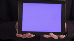 Hands holding bluescreen tablet Stock Footage