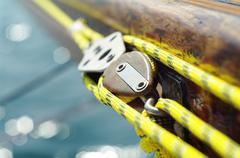 Stock Photo of closeup of mainsheet on old vintage wooden yacht with yellow rope,