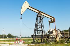Stock Photo of pumpjack pumps oil in kuban region, russia