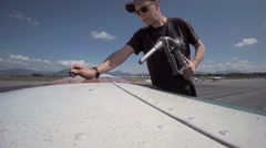 Man fueling a Cessna airplane. Stock Footage