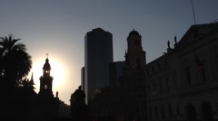 Sunset at Plaza de Armas tilt to the street with people in Santiago de Chile Stock Footage
