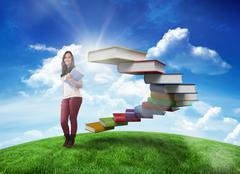 Composite image of smiling student holding textbook - stock illustration